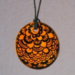 Orange zentangle pendant