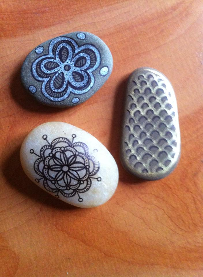 Stones decorated with zentangle patterns